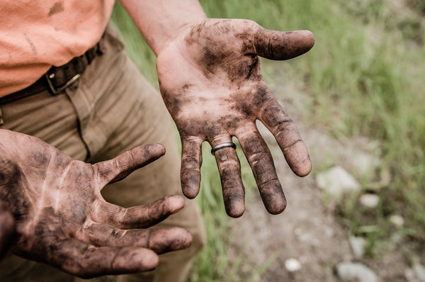 outdoors man with dirty hands