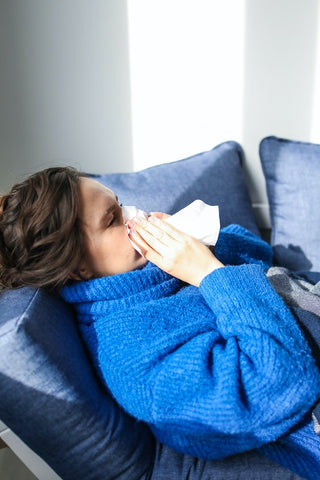 woman suffering from sinus congestion using eucalyptus nasal inhaler to help relieve congestion.