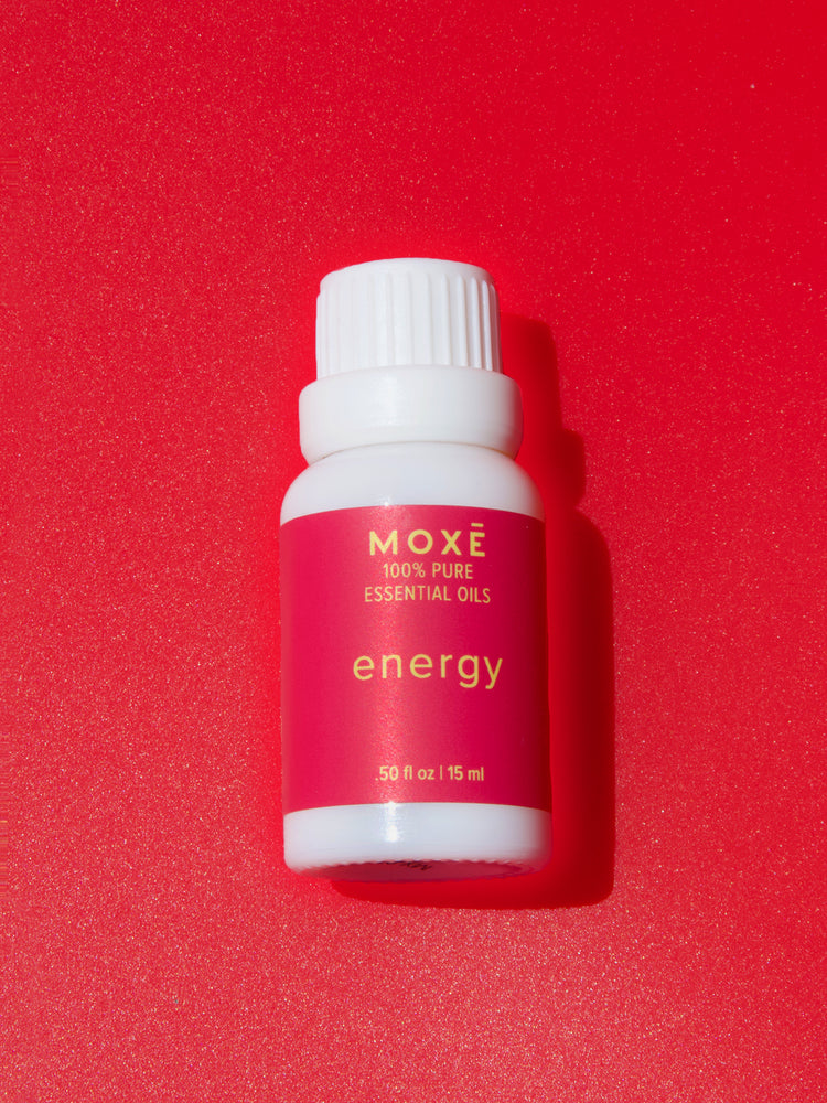 MOXĒ Energy Essential Oil with spearmint, grapefruit, bergamot, and sandalwood.