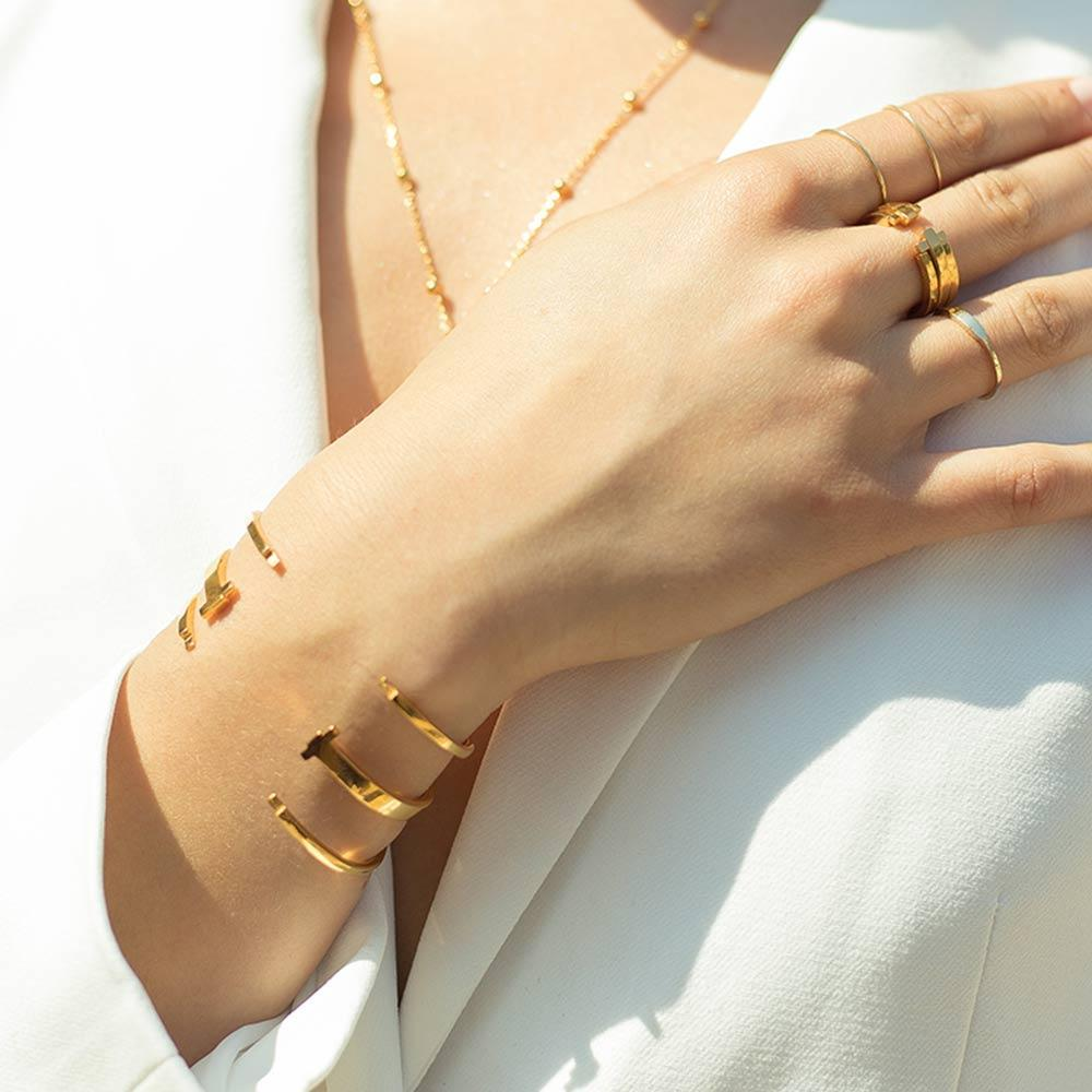 Astrid & Miyu - Crossing Lines Locking Bangle  - Gold