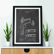 colt 1903 patent print, colt 1903 poster in the style chalkboard mocked up in a frame