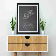 super nintendo NES controller patent print, super nitnendo controller retro gaming poster in the style vintage mocked up in a frame