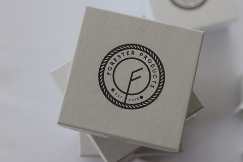 Forester Products vegan belt packaging by the Tiny Box Company