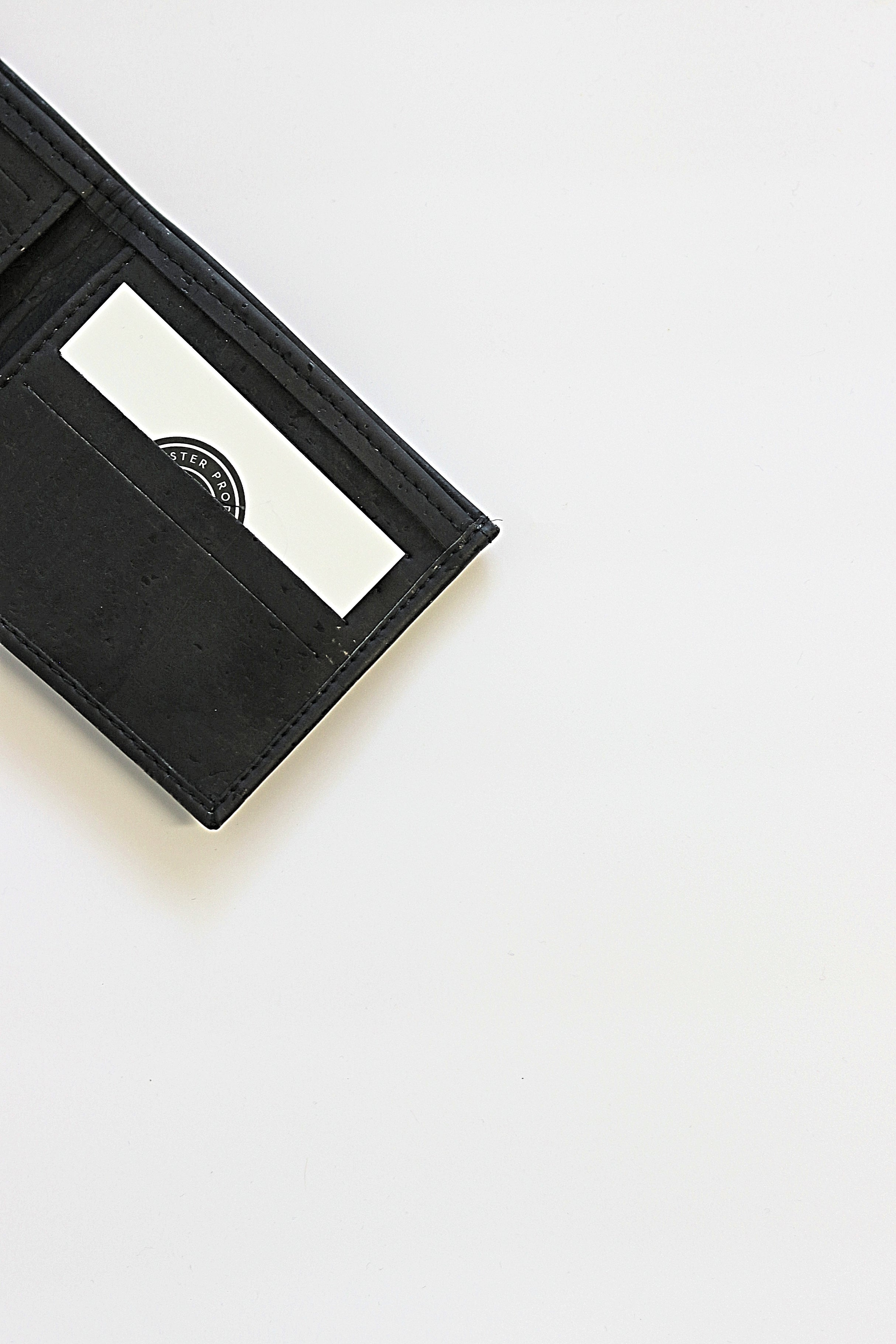 Forester Products black, sustainable, cork, vegan leather bifold wallet open view.
