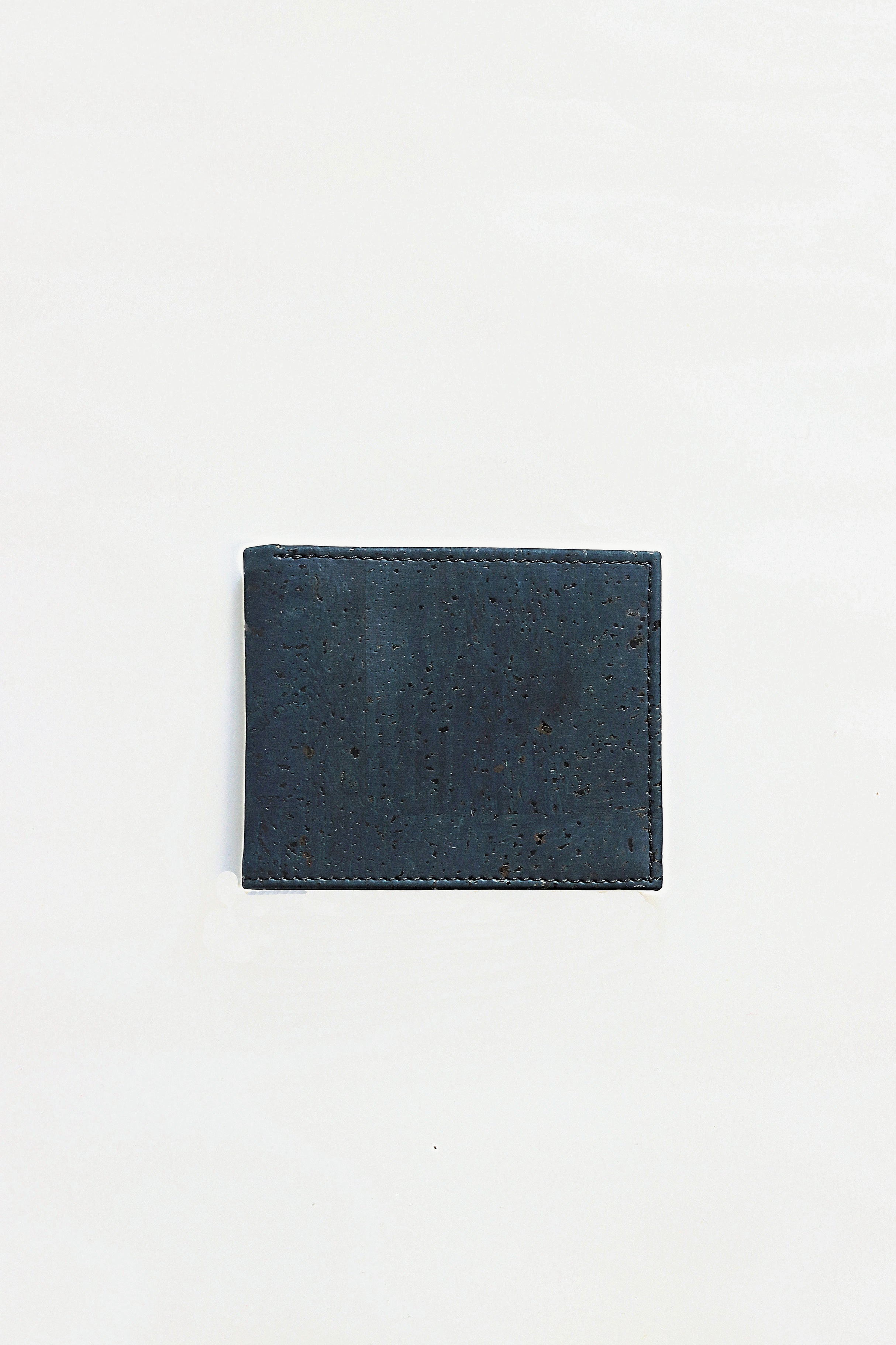 Forester Products navy blue, sustainable, cork, vegan leather bifold wallet front angle.