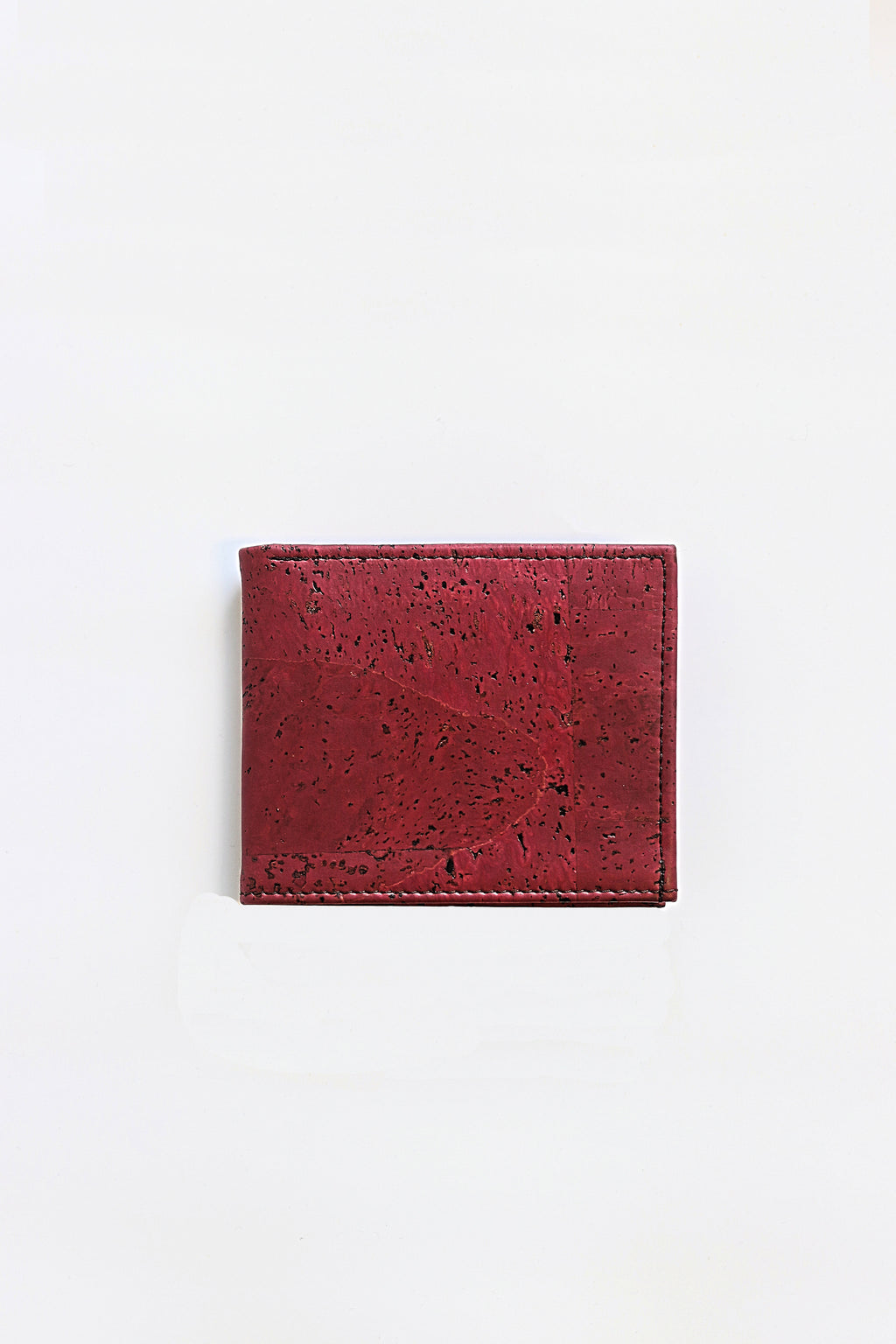 Forester Products red, sustainable, cork, vegan leather bifold wallet closed front view.