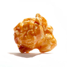 Close up image of one kernel of Old-fashioned caramel popcorn.