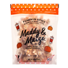 Image of one 6 ounce bag of Maddy & Maize Pumpkin Spice Vanilla Bean Latte popcorn. Bag is transparent and you can see seasoned popcorn drizzled with white chocolate. Drawn images of pumpkins and lattes are on the bag along with a large Maddy & Maize logo in the center.