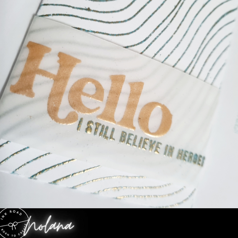 embossed vellum words on pocket with embossed wave background