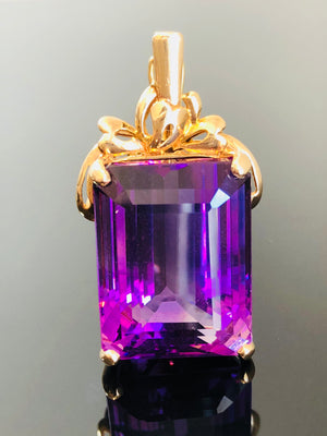 Ladies 14kt Gold Pendant/Enhancer with an Emerald Natural Amethyst, Intense Bluish Purple Color