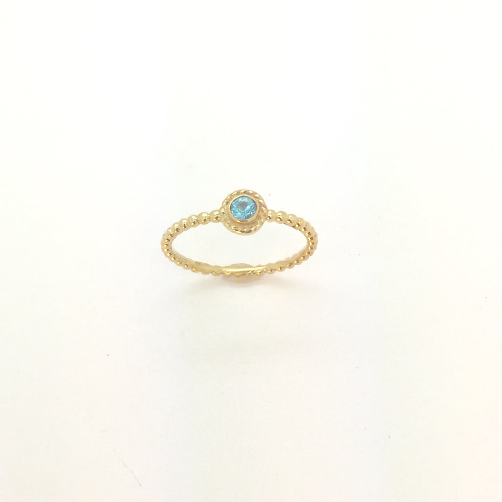 Gold ring in 14K with Blue Topaz