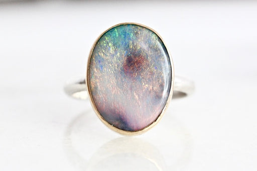 Oval Opal in 14k yellow gold and sterling silver