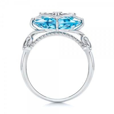14K White gold ring with diamonds and blue topaz