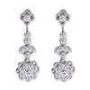 18K WHITE GOLD DANGLE FLOWER EARRINGS WITH DIAMONDS