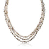 Three strand pearl necklace with 14K yellow gold beads