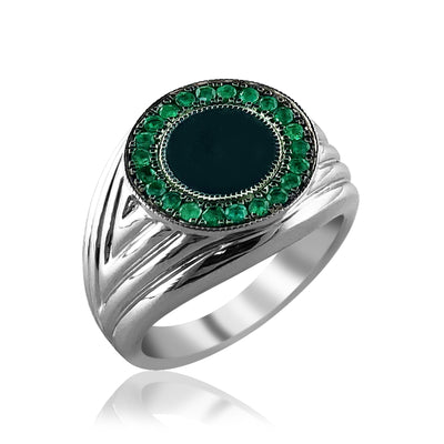 Sterling silver round ring with emerald