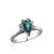 Sterling silver ring with cz's and center blue topaz