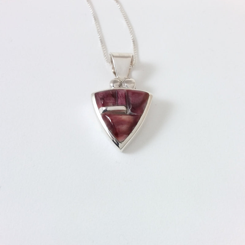 Navajo spiny oyster sterling silver inlay.
