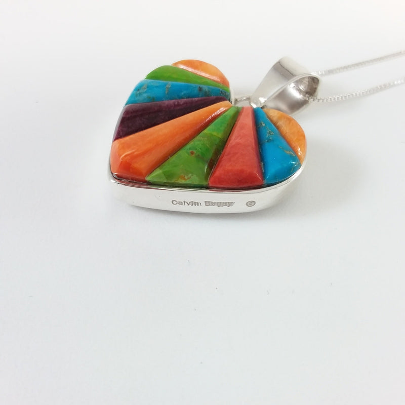 Navajo multi stone sterling silver double sided pendant.