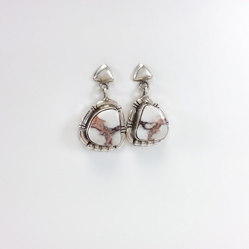 Melvin Francis Navajo white buffalo sterling silver earrings.