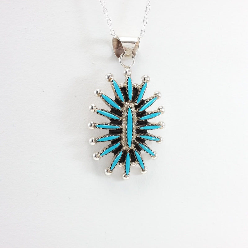 Gerald Etsate turquoise sterling silver needle point pendant