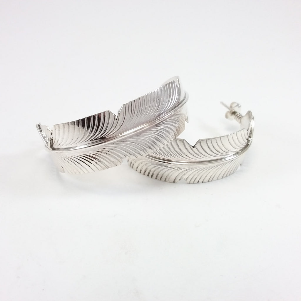Navajo sterling silver feather hoop earrings.