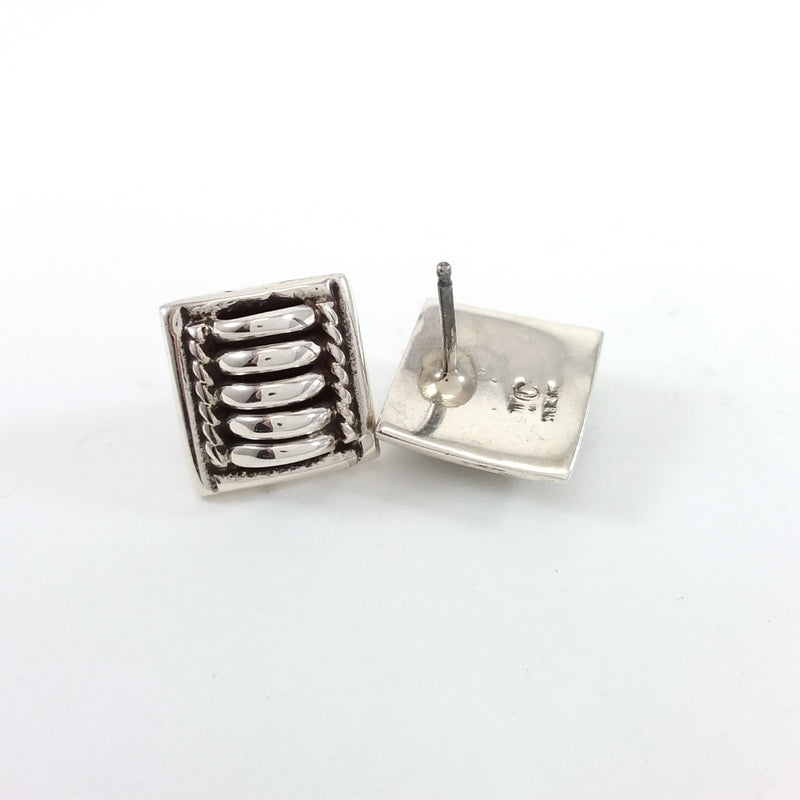 Thomas Charley sterling silver earrings.