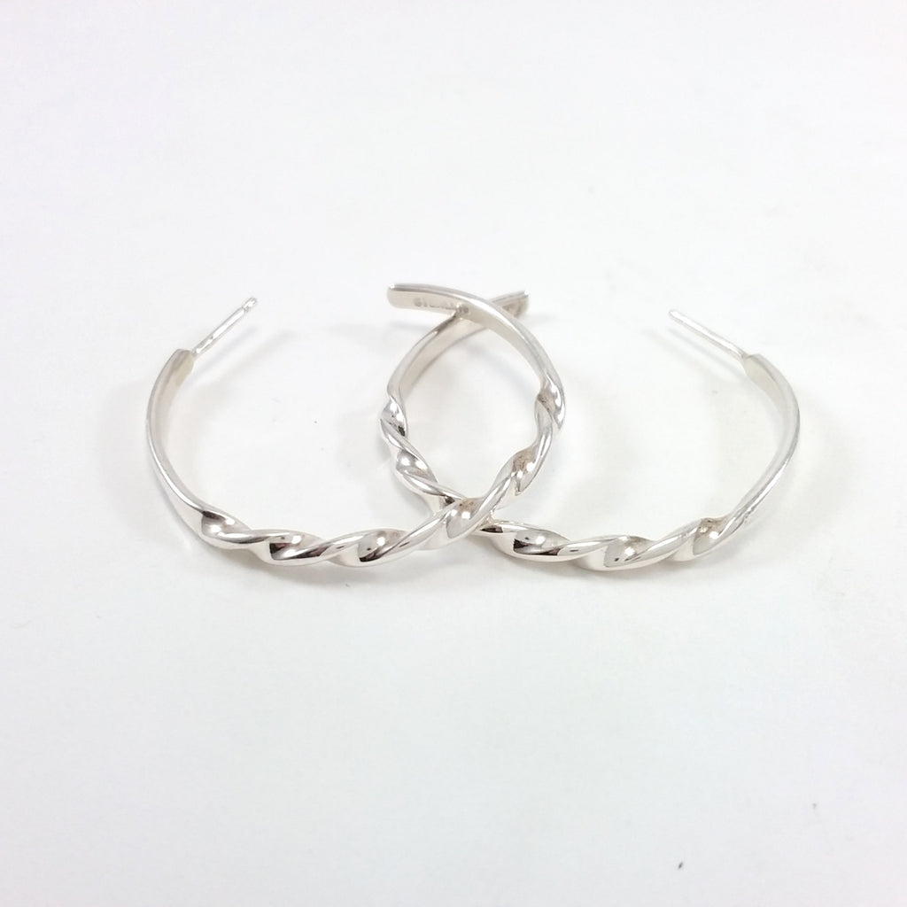 Navajo sterling silver twisted hoop earrings.