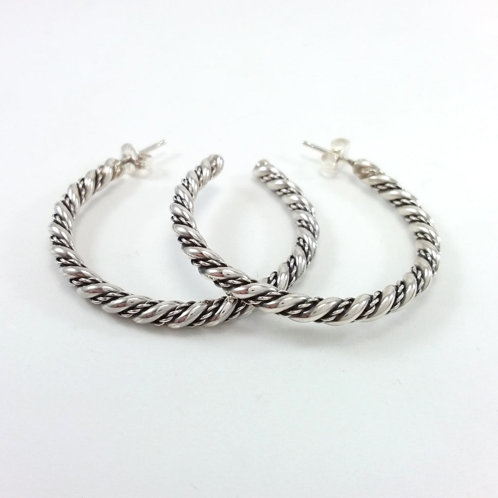 Navajo sterling silver twist hoop earrings.