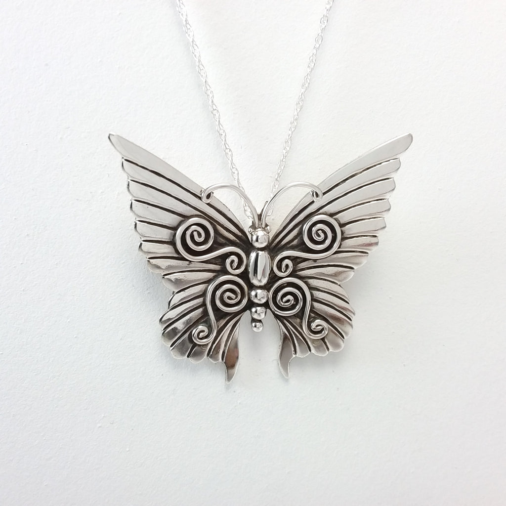 Navajo sterling silver butterfly pin/pendant.