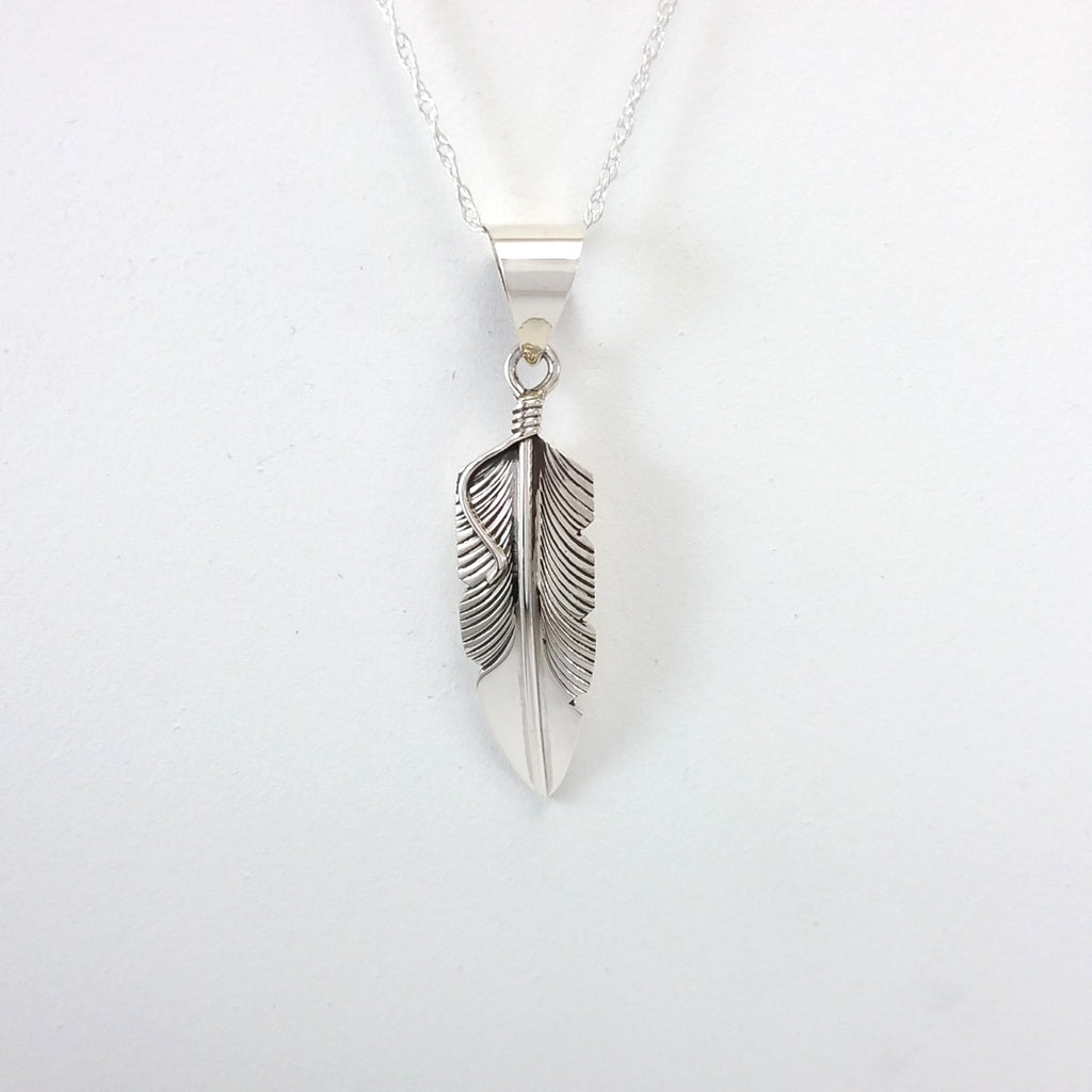 Navajo sterling silver feather pendant.