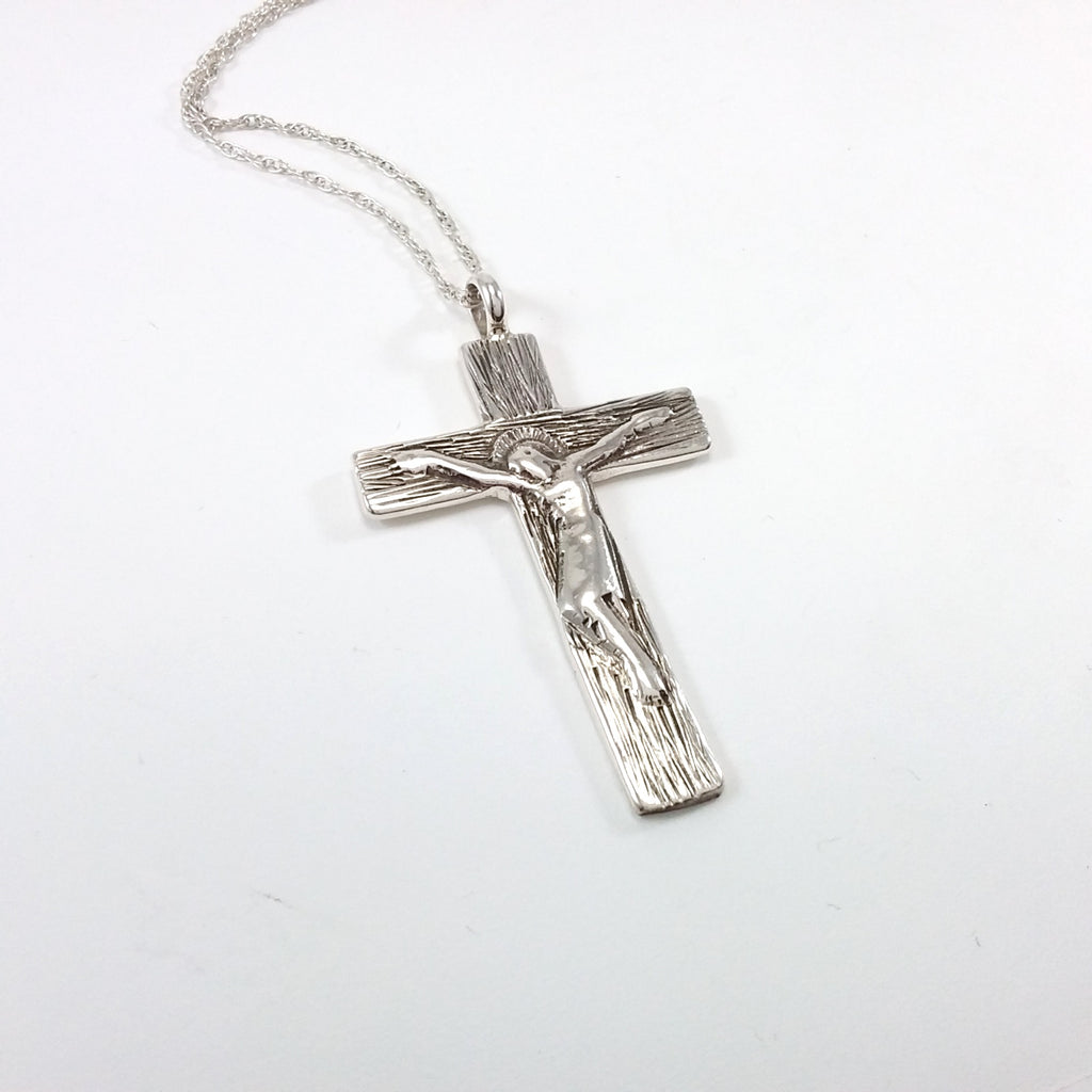 Navajo sterling silver cross pendant.