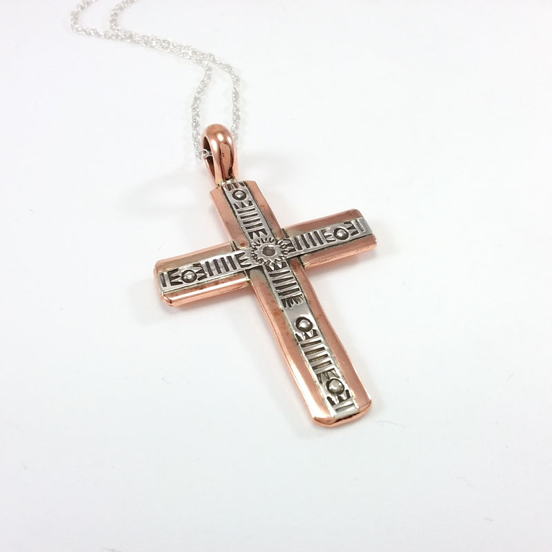 Navajo copper and sterling silver cross pendant.