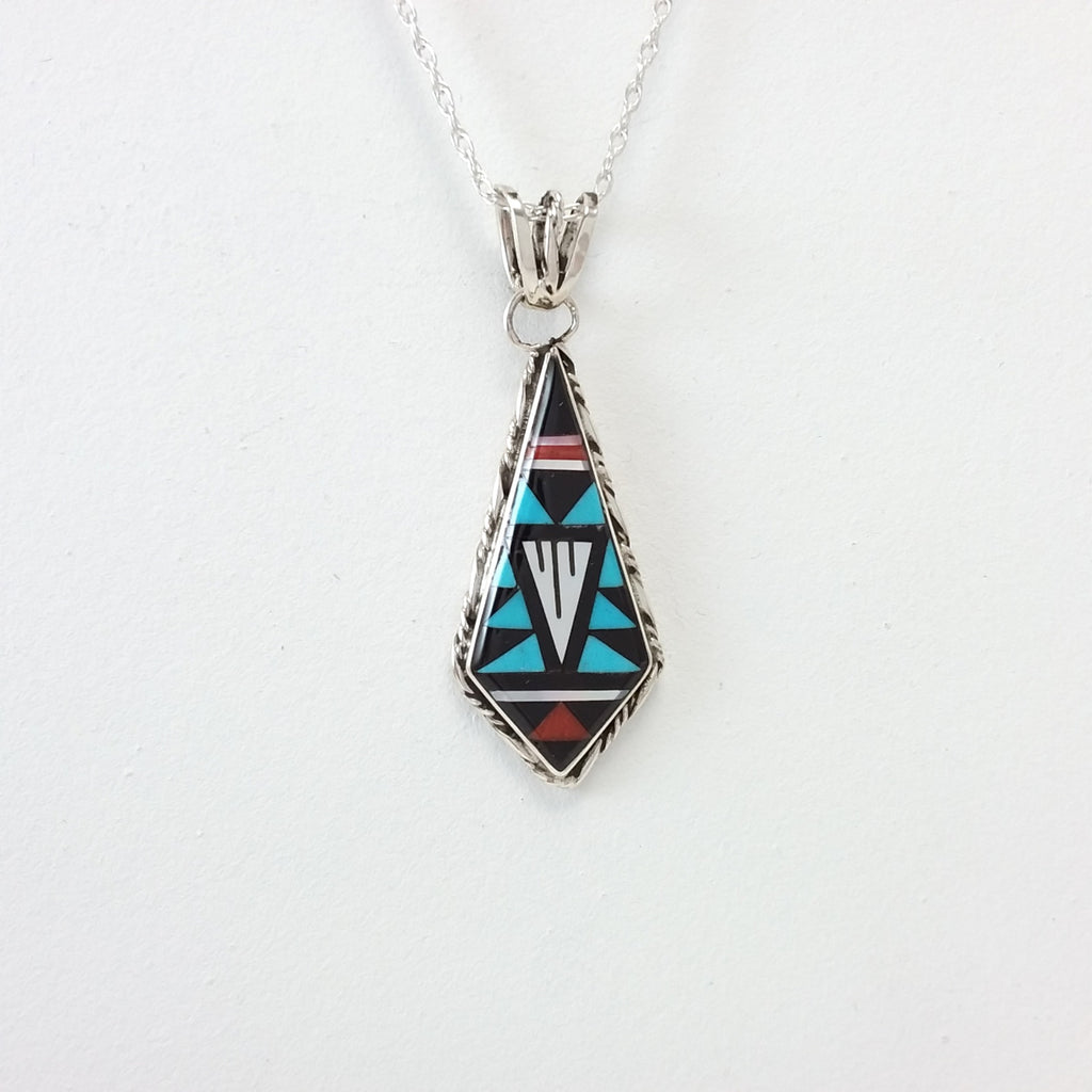 Zuni turquoiuse, coral, jet and mother of pearl sterling silver inlay pendant.