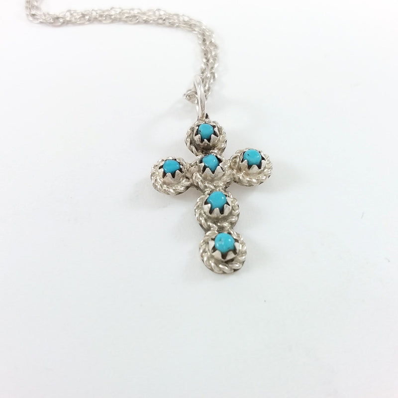 Navajo turquoise sterling silver cross pendant.