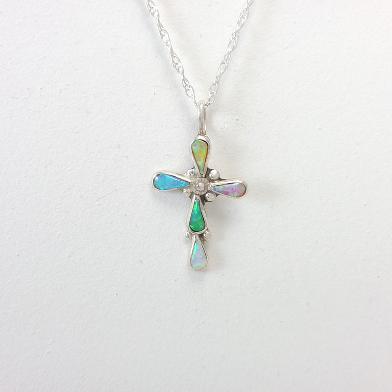 Navajo multi colored opal sterling silver cross pendant.