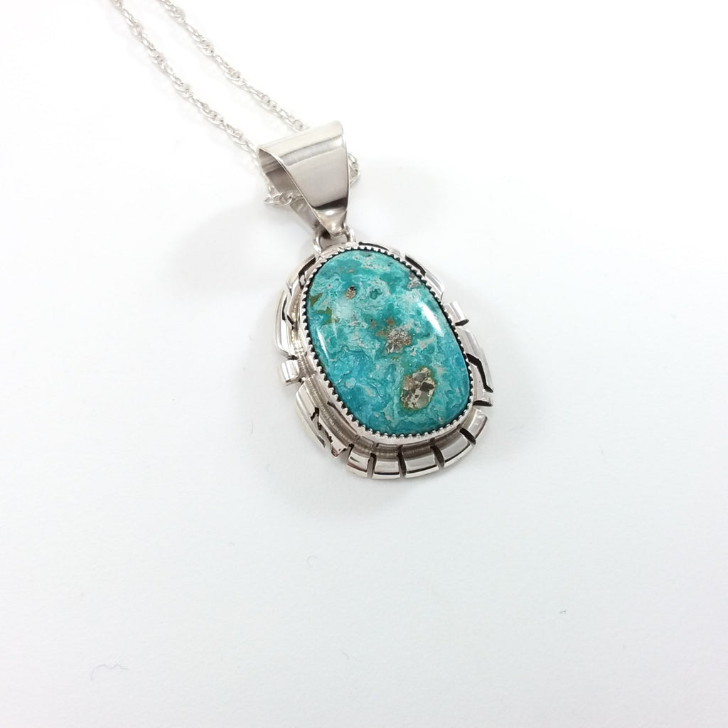 Peggy Skeets Navajo turquoise sterling silver pendant.