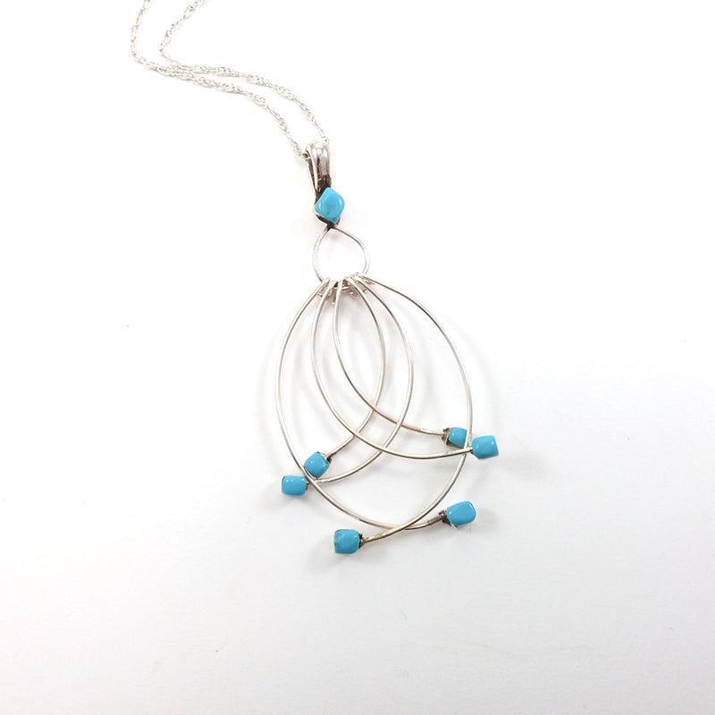 Navajo turquoise sterling silver dangle pendant.