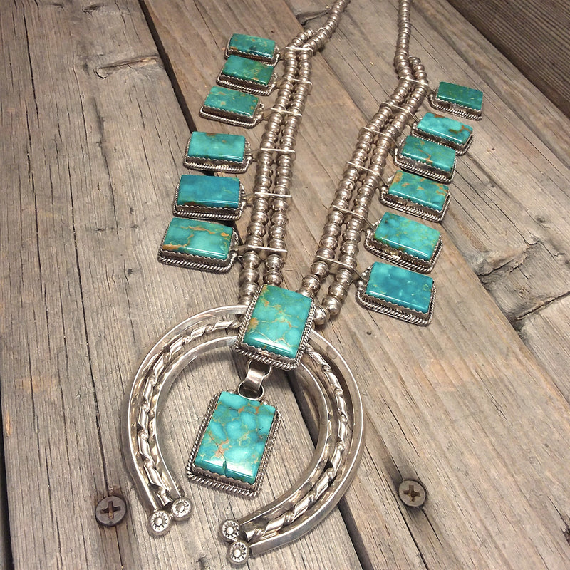 Nita Edsity Navajo turquoise sterling silver squash blossom necklace.