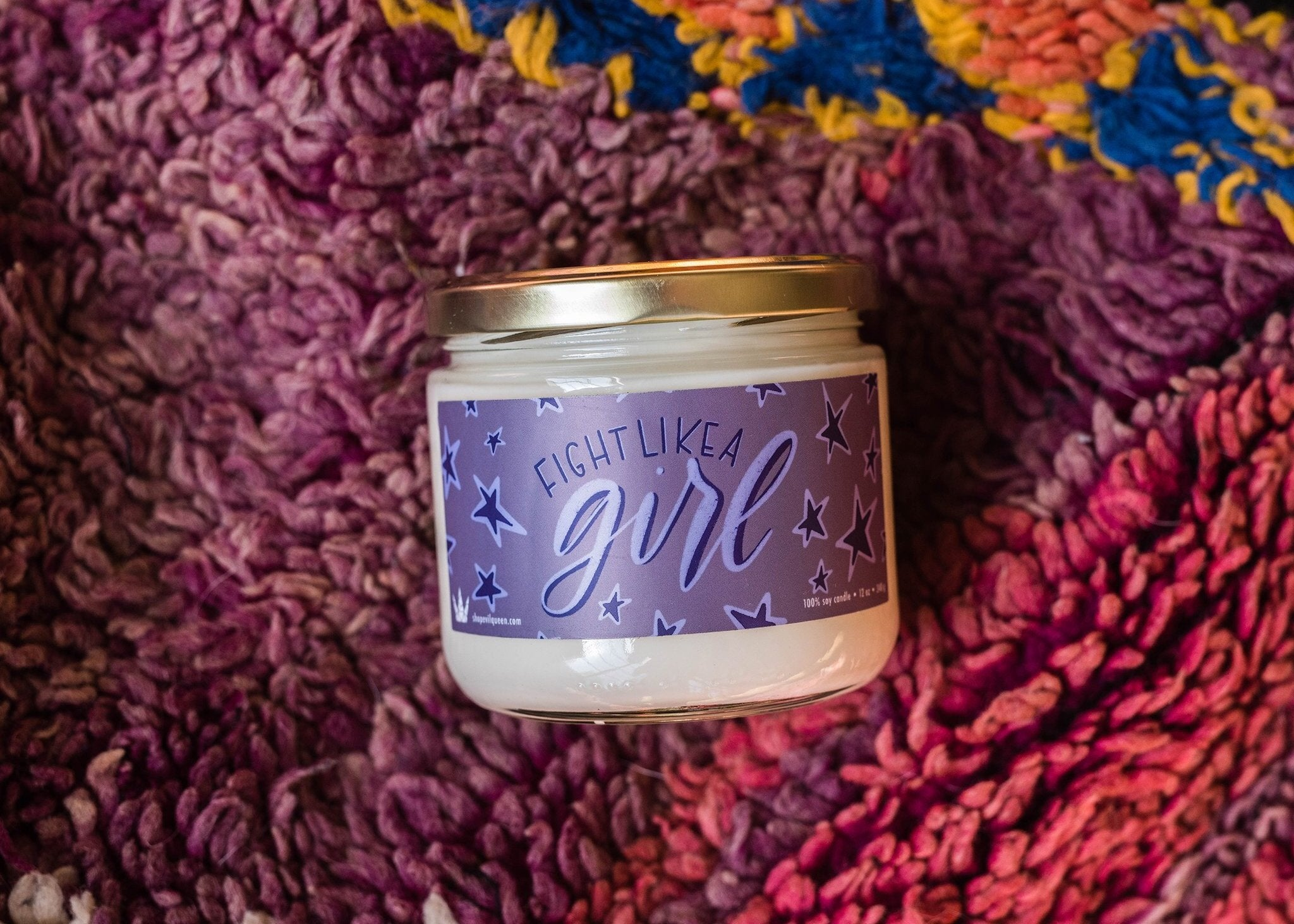 Fight Like a Girl vegan american soy hand poured candle in earthy tones with a hint sweet florals