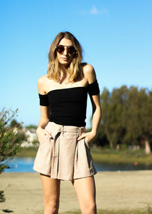 Taupe paperbag shorts with white stripes, pockets and an attached belt
