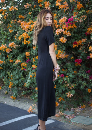 black jumpsuit with sparkle stitch and v neck