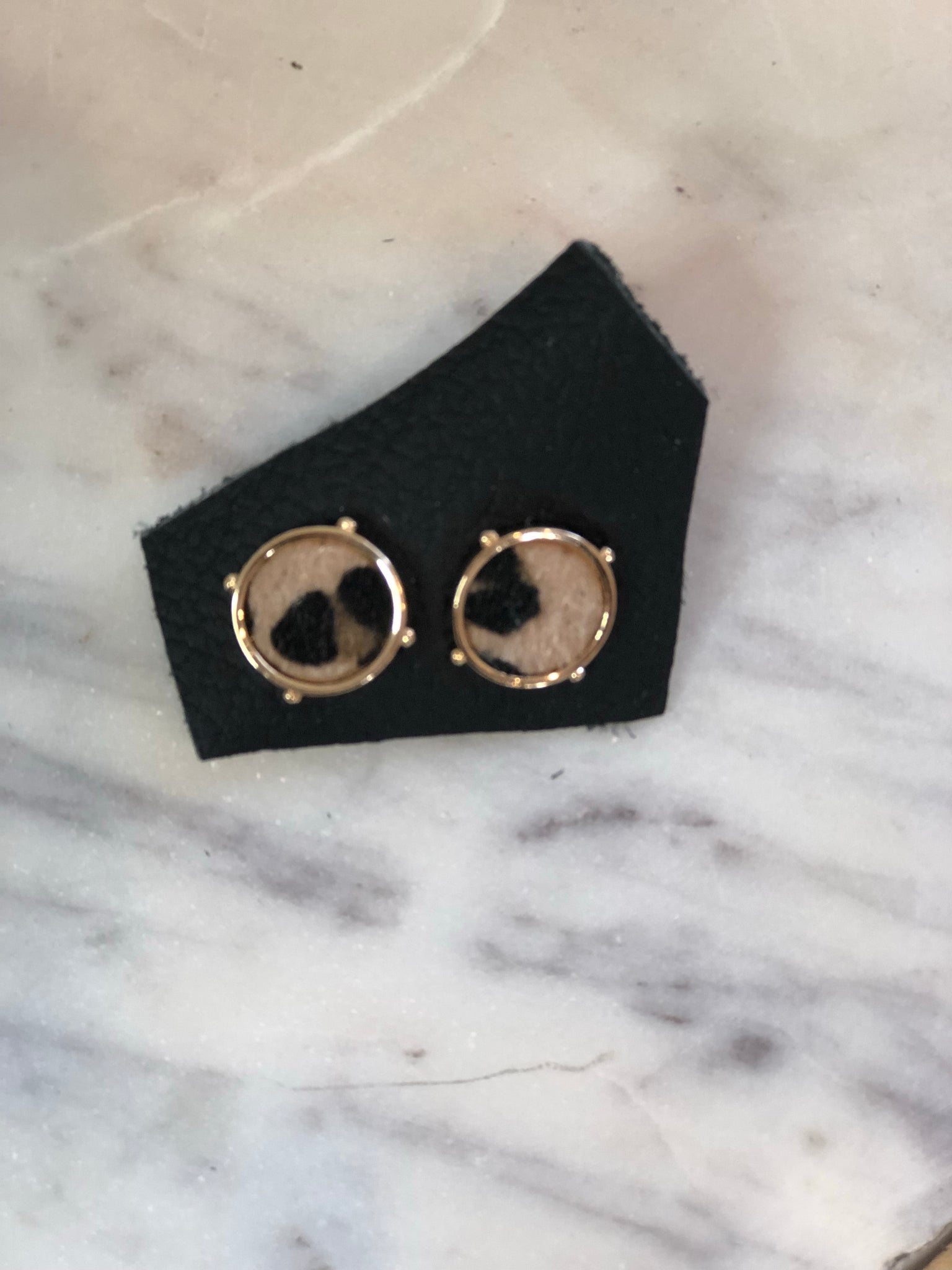 button earrings with cheetah detail