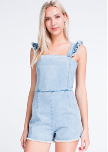 light wash denim romper with ruffle shoulder detail by Honey Punch