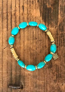turquoise and gold elastic bracelet handmade accessory African beads by Rope the Moon Jewelry