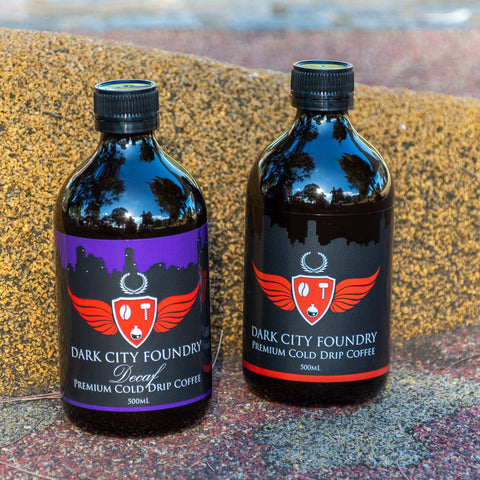 500ml bottle of decaf cold drip coffee next to 500ml bottle of cold brew coffee