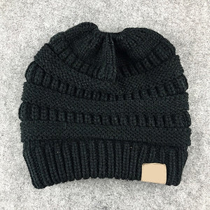 Dropshipping 2018 Winter Women Hat Ladies Girl Stretch Knit Hat With Tag Messy Bun Ponytail Beanie Holey Warm Hats Caps