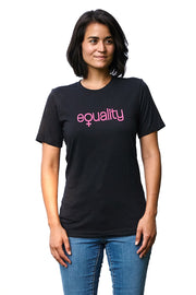 19th Amendment heather black, short sleeve, crew neck tee, t-shirt with pink hand-printed equality design representing women's equality. Donation goes to the Global Fund for Women. Buy One Give a Pair donation of socks to a shelter. Common Interest Clothing.