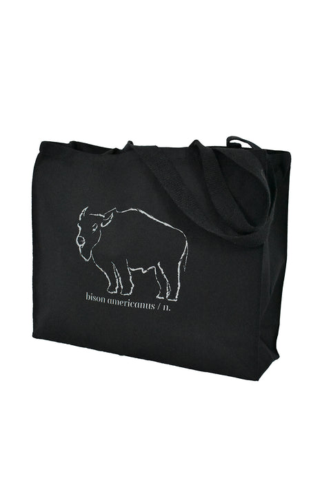 Bison Americanus black canvas, gusset bag with gray hand-printed design of bison and Bison Americanus saying underneath of image. A pair of socks will be donated to a featured shelter through our Buy One, Give a Pair program. Common Interest Clothing.