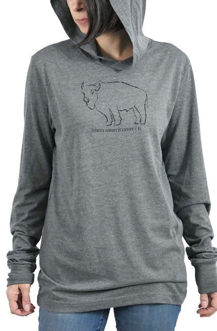 Bison Americanus deep heather, long sleeve, hoodie tee, t-shirt with chocolate brown hand-printed design of bison and Bison Americanus saying underneath of image. A pair of socks will be donated to a featured shelter through our Buy One, Give a Pair program. Common Interest Clothing.